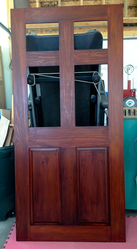 pantry door with dry third coat of stain